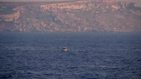 Small boat on the sea stock footage