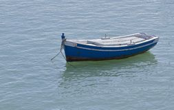 Small boat in the sea Stock Photos