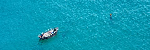 Small boat on the sea, panoramic aerial view in Guernsey. Small boat on the sea, panoramic aerial view,  in Guernsey Stock Images