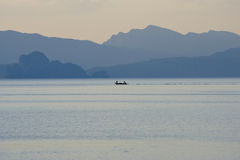 Small boat on the sea during sunset. Stock Photography