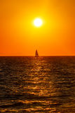Small boat on the sea in sunset Royalty Free Stock Photography