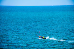 A small boat in the sea Royalty Free Stock Photo