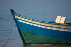 Small boat with seats. A small tourist at the water's edge Royalty Free Stock Images