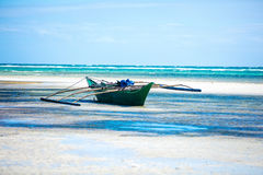 Small boat in shallow sea waters. Small asian boat in shallow sea waters stock images