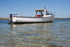 Small boat in shallow water in Brittany France Royalty Free Stock Photography