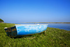 Small boat at the shore of the river Somme. Small boat laying on the grass at the shore of river Somme, Normandy, France royalty free stock photo