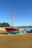 Small boat on the shore Stock Photo