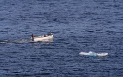 Small Boat and Small Iceberg Stock Photography