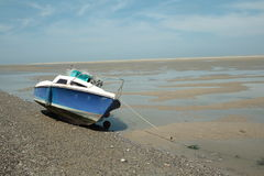 Small boat in Somme bay,France. Small boat in Somme bay,Picardy region of France royalty free stock photo