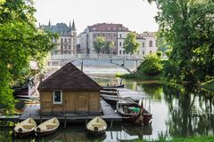 Small boat station. Little boat station with a bridge and river bank and old buildings behind Royalty Free Stock Photo