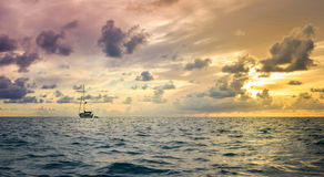 Small boat and stormy weather at horizon Stock Photo