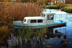 Small  boat summer landscape on the river Royalty Free Stock Photography