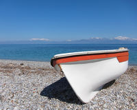 Small boat on sunny beach Stock Photography
