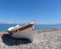 Small boat on sunny beach Royalty Free Stock Photography