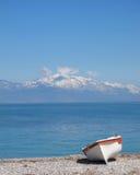 Small boat on sunny beach Royalty Free Stock Image