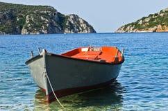 Small boat at sunny morning near the entrance to Porto Koufo harbor Royalty Free Stock Image