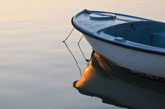 Small boat in sunrise light Royalty Free Stock Image