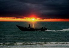 Small boat during sunrise Stock Images