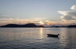 Small boat at sunset ,beautiful scenery  background. Stock Image