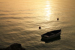 Small boat at sunset Stock Photo