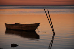 Small boat at sunset. In the gulf of Mexico, near the beach of Campeche in the Yucatan peninsula Royalty Free Stock Photography