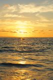 Small Boat at Sunset Over the Pacific Ocean Stock Photos