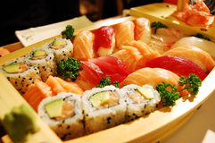 Small boat with sushi Royalty Free Stock Image