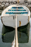 Small boat tied in little marina of Tivat harbor Stock Photo