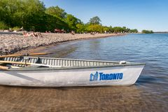 Small boat with Toronto city logo mooring at the Centre island beach 2019