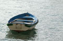 Small boat towards the sea Stock Photos