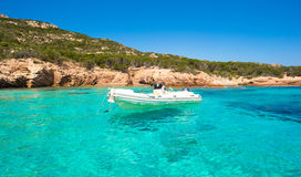 Small boat in turquoise clear sea Stock Image