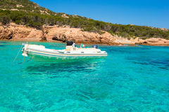 Small boat in turquoise clear sea Stock Photo