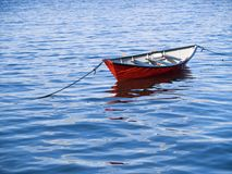 Small Boat in Vivid Water. Small Red Boat in Vivid Water Stock Images