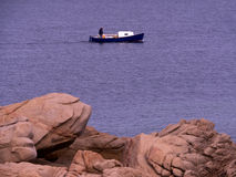 Small boat for a walk. Life of a retired fisherman Stock Photography