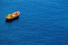 Small Boat On Water. Small boat on calm sea Royalty Free Stock Photos