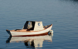 Small boat in the water with nobody Stock Image
