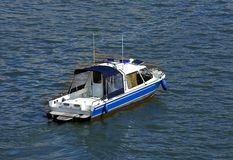 Small boat on the water, top view stock photography