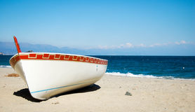 Small boat on a white beach Royalty Free Stock Photo