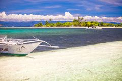 Small boat on white sandy tropical beach Stock Image