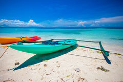 Small boat on the white sandy tropical beach and turquiose ocean Stock Photos