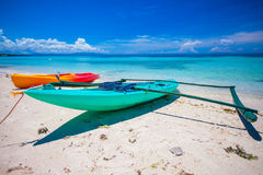 Small boat on the white sandy tropical beach and turquiose ocean Royalty Free Stock Photo
