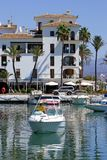 Small boat or yacht pulling into Duquesa port in Spain. On a sunny day royalty free stock images