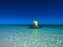 Small boat with yellow sails, romantic stock image