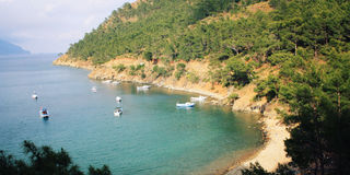 Small boats in the Adrasan Bay. Vintage photo. Royalty Free Stock Photo