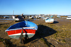 Small boats aground due to low tide Royalty Free Stock Photography