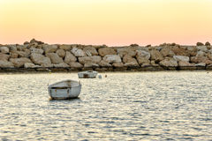 Small boats anchored in bay Stock Photo