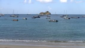 Small Boats Anchored in a Caribbean Bay. In Sint Maarten with a Small Island stock video footage