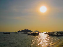 Small boats at the Andaman Sea in sunset Stock Photography