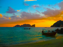 Small boats at the Andaman Sea in sunset Royalty Free Stock Photo
