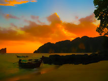 Small boats at the Andaman Sea in sunset Royalty Free Stock Image